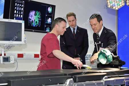 Stock Image of HRH Prince William Visits Alder Hey Childrenas Hospital Liverpool Merseyside To Officially Launch Their New Intra-operative 3-tesla Mri Scanner Facility. The Paediatric Intra-operative Scanner Is The First Of Its Kind In Europe And One Of Only Two Such Facilities World-wide. The Prince With Theatre Manager Steve Allen (l) And Consultant Paediatric Neurosurgeon Conor Mallucci (r).Pa - 22/2/10 Royal Rota - For General Distribution