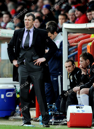 The Port Vale Manager Jim Gannon watches the match
