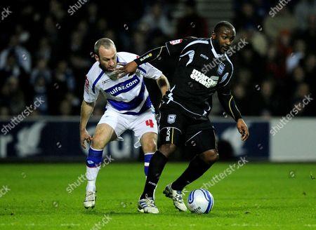 Shaun Derry of QPR and Jason Scotland of Ipswich Town