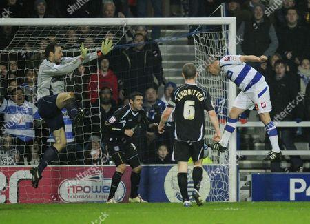Heidar Helguson of QPR scores the second goal past Ipswich Town goalkeeper Marton Fulop, 2-0
