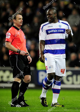 Danny Shittu of QPR argues with referee Kevin Wright