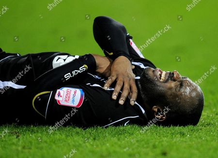 Jason Scotland of Ipswich Town winces in pain after colliding with QPR goalkeeper Paddy Kenny