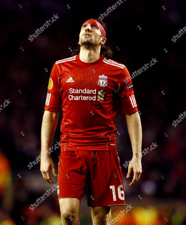 Sotirios Kyrgiakos of Liverpool looks to the heavens wearing a red bandage on his head