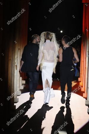 Lady Gaga with Nicolas Formichetti (R) and Sebastien Peigne on the catwalk