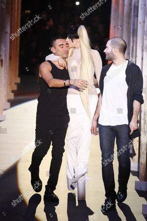 Lady Gaga with Nicolas Formichetti (L) and Sebastien Peigne on the catwalk