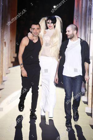 Stock Image of Lady Gaga with Nicolas Formichetti (L) and Sebastien Peigne on the catwalk