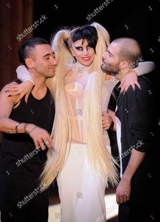 Stock Picture of Lady Gaga with Nicolas Formichetti (L) and Sebastien Peigne on the catwalk