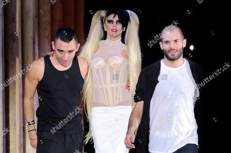 Stock Photo of Lady Gaga with Nicolas Formichetti (L) and Sebastien Peigne on the catwalk