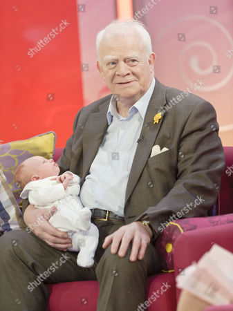 Stock Image of Ian McMean with baby daughter Kate Eleanor