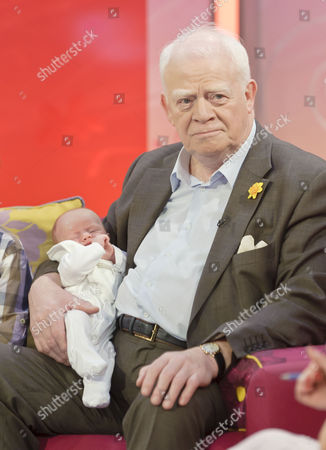 Stock Picture of Ian McMean with baby daughter Kate Eleanor