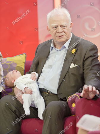 Stock Photo of Ian McMean with baby daughter Kate Eleanor