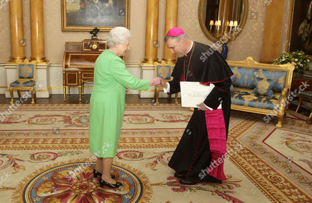Stock Image of Queen Elizabeth II receives His Excellency the Apostolic Nuncio, Archbishop Antonio Mennini at Buckingham Palace where he presented his Letter of Credence.