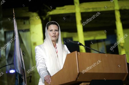 Ayesha Gaddafi, daughter of Lybian leader Muammar Gaddafi, addresses the audience before a charity peace concert