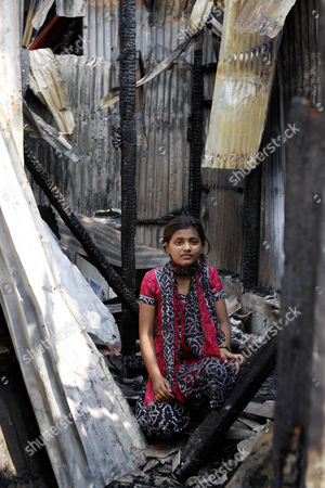Slumdog Millionaire star Rubina Ali surveys the wreckage after her home was destroyed by fire