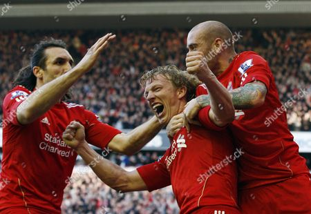 Dirk Kuyt of Liverpool celebrates scoring his goal to make it 3-0 and completing his hat-trick with team-mates Raul Meireles and Sotirios Kyrgiakos