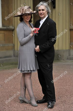 Stock Photo of Alexis Redmond awarded an OBE, with husband Phil Redmond