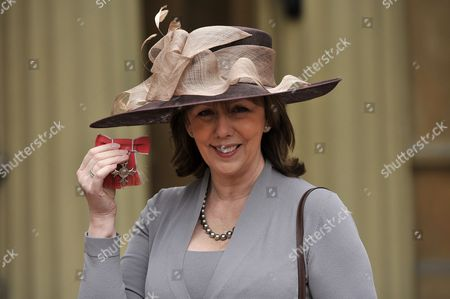 Stock Picture of Alexis Redmond awarded an OBE