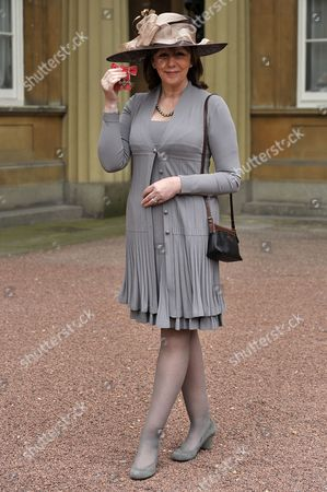 Stock Image of Alexis Redmond awarded an OBE