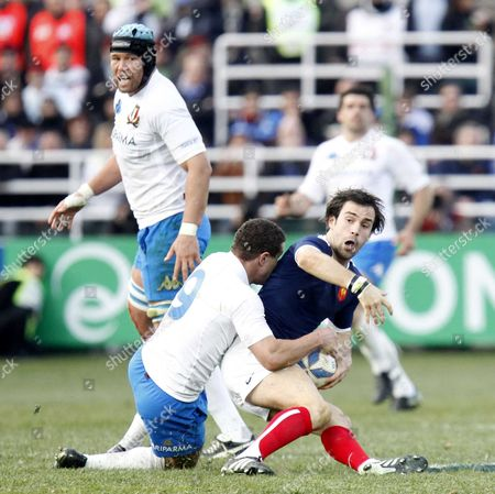 France's Morgan Parra (right), and Italy's Fabio Semenzato fight for the ball