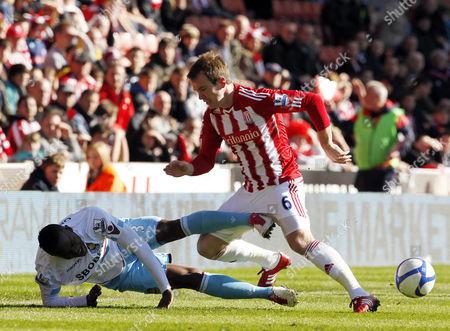 Victor Obinna of West Ham United and Glenn Whelan of Stoke City