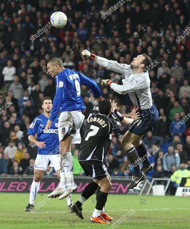 Ipswich Town goalkeeper Marton Fulop punches clear under pressure from Cardiff City striker Jay Bothroyd