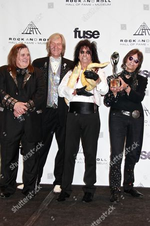 Inductees Michael Bruce, Neal Smith, Alice Cooper and inductee Dennis Dunaway pose with a snake