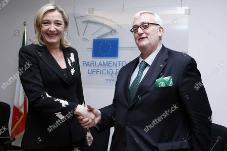 Marine Le Pen, President of the National Front with Mario Borghezio, MEP from Italy's anti-immigration Northern League party