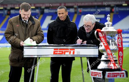 ESPN Presenters Ray Stubbs, D.J. Campbell of Blackpool, and Kevin Keegan prepare their notes with the FA Cup in front of them