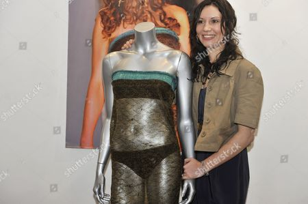 Designer Charlotte Todd with her dress worn during a fashion show by Catherine Middleton
