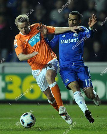 David Carney of Blackpool and Jose Boswinga of Chelsea