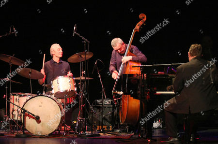 Charlie Watts performs with Ben Waters and Dave Green