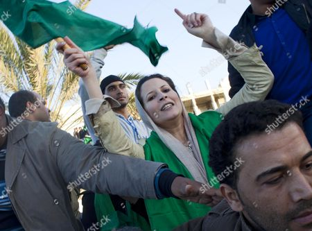 Editorial picture of Gaddafi supporters rally to form human shield at Bab al-Azizia, Tripoli, Libya - 20 Mar 2011