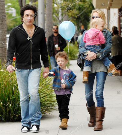 Paul Stanley, son Colin Michael, and partner Erin Sutton carrying daughter Sarah Brianna
