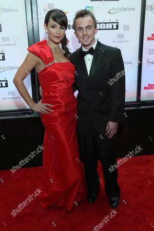 Stock Photo of Frankie Muniz with  Elycia Marie