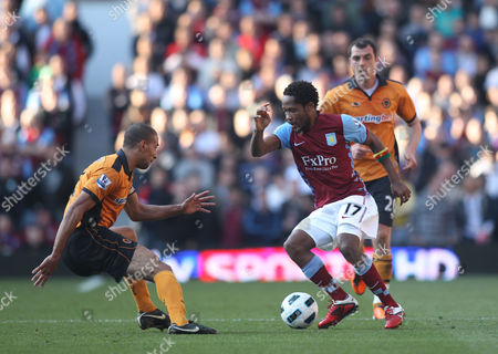 Jean Makoun of Aston Villa in action with Karl Henry as Nenad Milijas of Wolves looks on