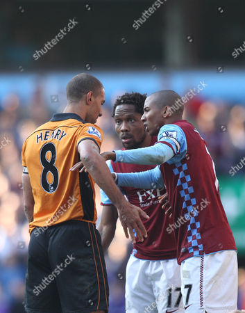 Karl Henry of Wolves  argues with Ashley Young and Jean Makoun of Aston Villa
