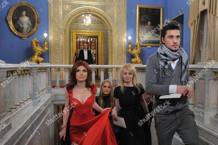 Anna Chapman (L), producer of Dima Bilan, Yana Rudkovskaya (2nd R) and Dima Bilan (R),