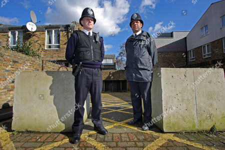 Editorial image of Sgt Jeff Palmer And Pc Allan Douglas-smith (right) Patrol The Streets Myatts Field Estate Clapham Known For Its High Gang Violence And Robbery. News Feature On Inner London Poverty. Pictured A Fading Tribute To Gang Member 'ratty' Who Was Shot Dead