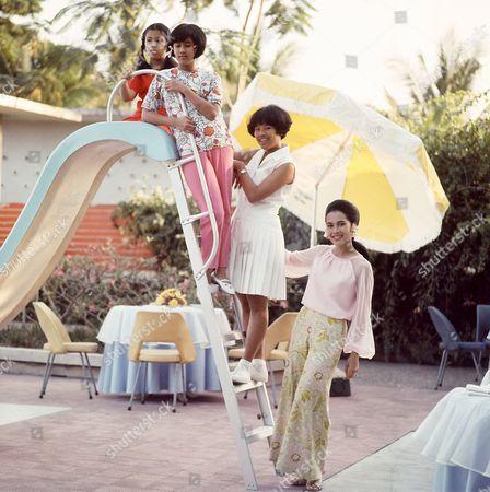 Beside the pool in Chitralada Palace, Bangkok, Queen Sirikit with Princess Ubolratana Rajakanya, Princess Maha Chakri Sirindhorn, Princess Chulabhorn Walailak, Thailand