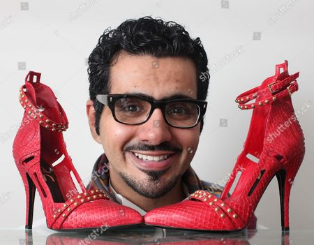 Stock Image of London based Emirati shoe designer, Sultan al Darmaki with a pair of shoes from his new collection.