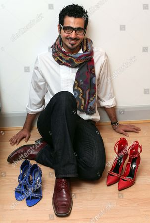 Stock Photo of London based Emirati shoe designer, Sultan al Darmaki with some of the shoes from his new collection.