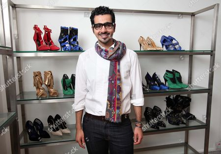 Stock Picture of London based Emirati shoe designer, Sultan al Darmaki with some of the shoes from his new collection.