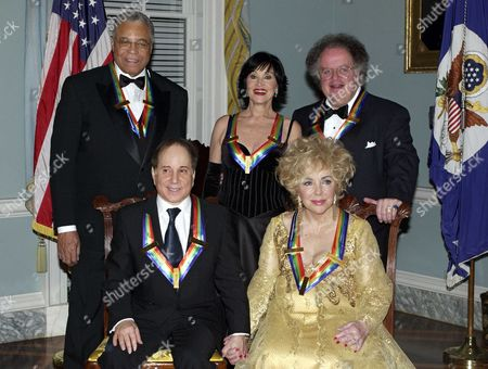 Stock Photo of Clockwise from lower right, actress Elizabeth Taylor, singer Paul Simon, actor James Earl Jones, theater actress Chita Rivera, and conductor James Levine. They were honored at a State Department dinner for their lifetime contributions to American culture through the performing arts.