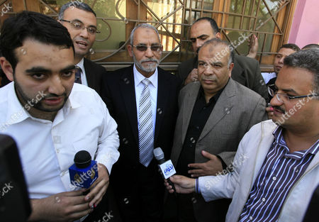 Mohammed Badie, head of Egypt's Muslim Brotherhood outside a polling station after casting his vote