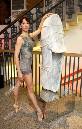 Stock Photo of Marta Romagna and a sculpture of a Tod's shoe