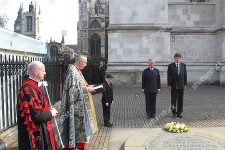 Stock Photo of Prince Charles laying a wreath on the Innocent Victims Memorial outside Westminster Abbey, watched by HIs Excellency Derek Leask, High Commissioner for New Zealand.