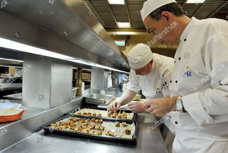 Royal Chef Mark Flanagan (right) Head of Kitchens at Buckingham Palace, London, watches as food is prepared, in the kitchens at Buckingham Palace