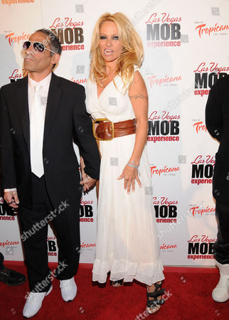 Marcus Suarez and Pam Anderson
