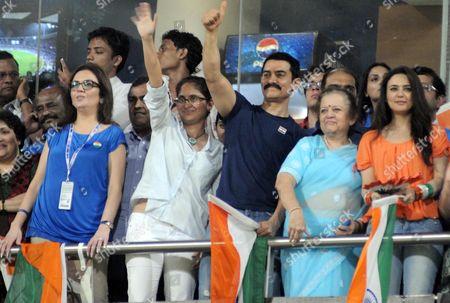 Wife of Reliance Industries chairman Nita Ambani, Indian film star Kiran Rao with wife, Bollywood star Aamir Khan, Kokilaben Ambani, mother of Reliance Industries chairman Mukesh Ambani and Indian film star Preity Zinta celebrate the Indian win