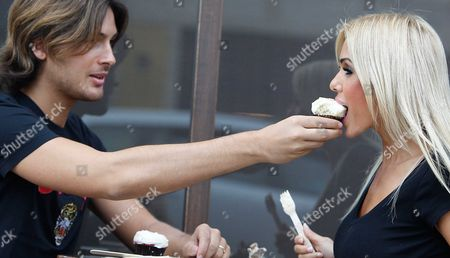 Stock Photo of Laurent Homburger and Shauna Sand eat cupcakes in Beverly Hills